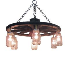 Alpha Omega Western Furnishings WWSACHAN24MJ 24-in Wagon Wheel Chandelier | ATG Stores Wheel Chandelier, Western Decor, Cabin Decor, Mason Jar Lighting, Wagon Wheel Chandelier Diy, Chandelier, Diy Lighting, Rustic House, Wagon Wheel Light