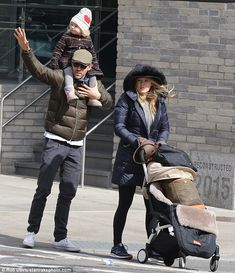 Hoping for a ride: Ryan Reynolds tried to wave down a cab after taking Blake Lively and their two-year-old daughter James for breakfast in the Soho neighborhood of the city on Saturday