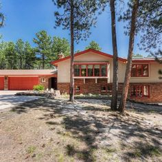 This custom built home in Arrowwood is situated on very private treed 2.60 acre lot and features multiple outdoor entertaining areas along with two separate sunrooms. Brick And Wood, Brick Pavers, Custom Built Homes, Backyard, Patio, Built In Cabinets, Large Windows, Outdoor Entertaining, Stairways
