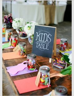 Kid's table. This way, they can all interact, and get to know one another. Not to mention, the adults can have some adult time! :)