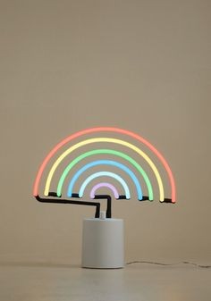 <p>Call upon this neon light whenever your quirky decor could use a new, fun-loving friend! Equipped with a dimmer to customize its levels of brilliance in addition to a rainbow shape and gorgeous hues to match, this lamp will have house guests singing your praises over the vivacious vibe of your space.</p>