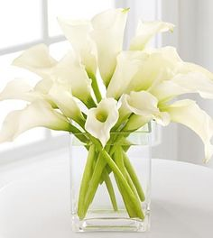 Table flowers    Google Image Result for http://callalilybouquets.net/wp-content/uploads/2011/08/calla-lily-bouquets-seven.jpg