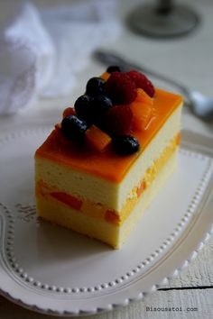 Bisous À Toi: Mango Mousse Cake  I've actually had this cake before minus the fruit on top and if you love mango like I do, it is Delicious!!!