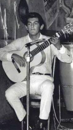Young Tony Bellamy playing flamenco guitar at his parents restaurant