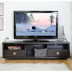 @Overstock - Unexpected design elements and simple style make the Jinna entertainment center the perfect place for your television and home theater accessories. This TV stand comes in a dark brown wood veneer and has places for all your electronic components.  http://www.overstock.com/Home-Garden/Jinna-Wooden-Modern-TV-Stand/6161968/product.html?CID=214117 $249.04