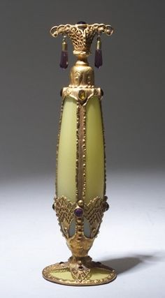 DEVILBISS Imperial perfume bottle, circa 1920's,in glass shading yellow to opal, glass jewels in metal filagree