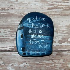 This lighthouse against a nighttime ocean with the comforting passage of Psalm 61:2 is hand painted with LOVE on a lake Michigan beach stone. Painted with the best quality acrylic paints and coated with several layers of varnish, signed and dated by the artist. This will look great sitting on a desk, on a shelf, tucked in a house plant, or even to carry in your pocket! This is a one-of-a-kind item, the only one like it. A true collectible for any Christian lighthouse lover!  Approximate…