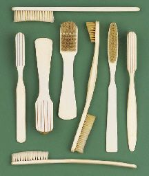 Eight early 19th-Century ivory tooth-brushes,