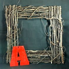 """Let your creative side run wild with our square block monogram grapevine wreath starter kit. This starter kit comes with a 20"""" square grapevine wreath, and your monogram. You get to decide how and where to attach the monogram... glue it to the side, tie it with a bow to the top, let it hang from ribbon in the center... the choice is yours. Then the fun begins. Add flowers made of felt., yo-yos made from fabric, pom-poms made from yarn...the possibilities are endless!"""