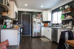 Black paint in the kitchen looks nice with the white cabinets. Jaclyn's Cozy Kitschy Silver Lake Home #black #white #bw #kitchen