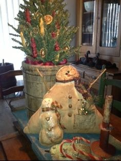 Snowmen on buggy seat -  But look at the tree!  Good idea.
