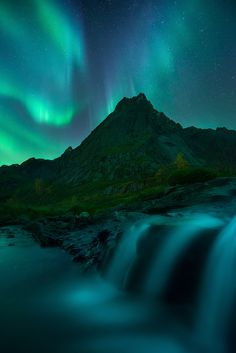 "October Lights - A fantastic display of the Northern lights in the Lofoten Islands. On this insane night me and Ryan took the group to some of our favourite locations on the islands. Waterfalls and crazy mountains. What a night!  Check out our website for tours and workshops in prime locations around the world <a href=""http://www.lofotentours.com"">www.lofotentours.com</a>"