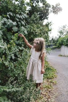 Our signature pinafore in Natural linen. 3 wooden button closure down the back. Sizing is tts. Style tip: If you want a shorter above knee look make sure to size down. Laundry Instructions: Gentle cyc