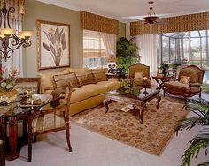 Elegant-living-room-with-yellow-leather-sofa-wooden-armchairs-glass-wooden-coffee-table-Persian-carpet-marble-tiles-glass-dining-table-wooden-dining-chairs-and-picture