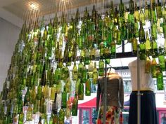 ... bottles @ Anthropologie: I remember the first time I walked into one of their stores and saw a similar installation stretching above the length of the sales desk (note to self FIND picture!) ... and I've not fallen out of love with their displays since
