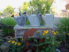 :) Galvanized watering cans...and we know exactly how to age them