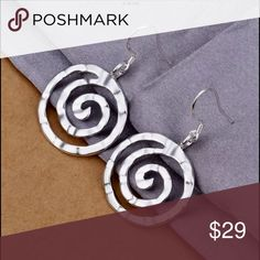 Sterling silver 925 geometric circle drops Circular drop earrings in 925 silver, with a patt run on one side and satin finish on the other. Free People Jewelry Earrings