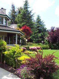 Front yard landscaping like this makes your home more valuable and easier to sell.