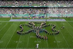 Members of the Notre Dame Marching Band form a cloverleaf during halftime of the 2012 Emerald Isle Classic against Navy at Aviva Stadium in Dublin, Ireland. Photo by Barbara Johnston/University of Notre Dame