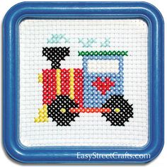 "TRAIN ENGINE THAT COULD --55TN This counted-cross stitch kit includes 6-count Aida cloth and a 5""x5"" Blue Square Hoop-Frame for Stitching and Framing -- EasyStreetCrafts.com"