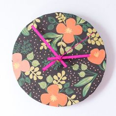 Upcycle a wall clock with pretty wrapping paper for an instant boost