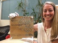 Our Manager Cara Carmichael is excited that RMI's Living Building Challenge plaque has arrived in our Boulder office! The team is honored that our Innovation Center received the world's most rigorous proven performance standard for green buildings. Future Inventions, Trophy Plaques, Acrylic Trophy, Eagle Statue, Plaque Design, Custom Trophies, Custom Awards, Innovation Centre, Green Building