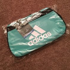 ADIDAS Diablo Small Duffel Bag Teal Green This is a brand new and authentic item from ADIDAS. Comes with all tags attached. Limited edition color. Unable to model due to the fact that handles are attached together and I don't want to compromise the original packaging in anyway ;) Adidas Bags Crossbody Bags