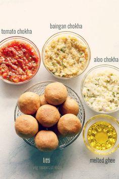 litti chokha recipe - a rustic and traditional dish of stuffed whole wheat dough balls, where the stuffing is a spiced mix of roasted gram flour or sattu. #litti