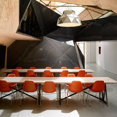 The Vitra Eames Plastic Side Chair DSS-N can be stacked. As flexible seating solutions in auditoriums, conference facilities, media rooms, assembly halls and similar spaces, the Eames Plastic Chairs have proven their worth over decades of use.