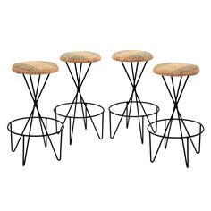 Set of 4 Sculptural Bar Stools by Paul Tuttle  USA  1950's  Set of 4 sculptural bar stools in wrought iron with upholstered seats by Paul Tuttle, American 1950's. Seats in original Mario Testino graphic fabric.