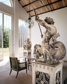 Commanding terra-cotta Tritons, which once adorned a 19th-century Viennese bank, now guard the orangery.