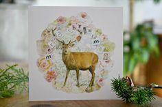 Tarjeta de Navidad con ciervo y flores