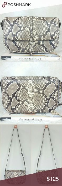 "BANANA REPUBLIC snake embossed crossbody Olivia Palermo's pick. Snakeskin embossed leather half-moon crossbody bag. Back pocket with snap button closure. Flap front with slip on buckle closure. One inner pocket. Zip closure. Color: snake skin print (natural/taupe).   Measurement approximately: 11""W x 8""H x 2.5""D with 48"" strap length.   NWT. Never worn. Can provide more pictures and info upon request. Banana Republic Bags"