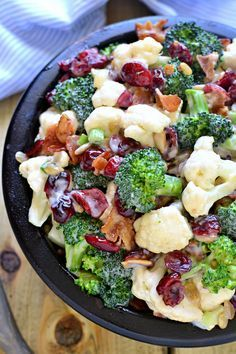 The BEST Broccoli Salad recipe - loaded with fresh broccoli, cauliflower, green onions, bacon, sunflower seeds, dried cranberries, and a lightened up honey mustard dressing