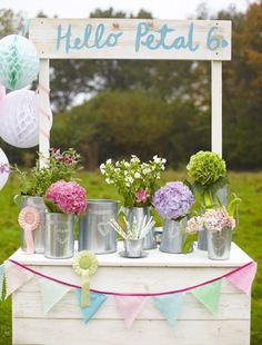 Display flowers on your table or around the dining area using florist-style galvanized steel buckets (Retreat Home).