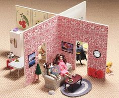 DIY dollhouse made from two pieces of foam core, scrapbook papers, and magazine cut-outs. Cute, cheap, and easy to store. Keep the furniture in a bin nearby. Originally from Cookie Magazine.
