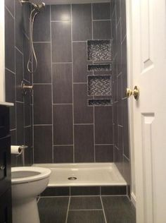 Hey Sara, I found a picture of the floor tile being used vertically in the shower (and on the floor).