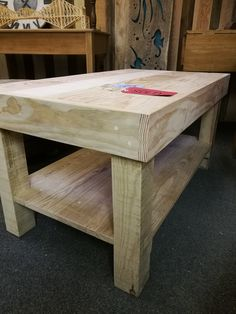 Coffee table created from reclaimed pallet wood and post sections. Sanded, natural finish