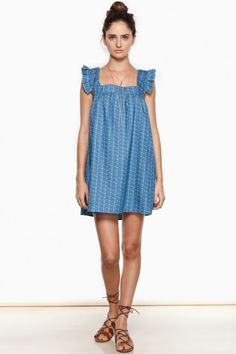 A baby doll dress rendered in chambray, with flirty ruffled sleeves.