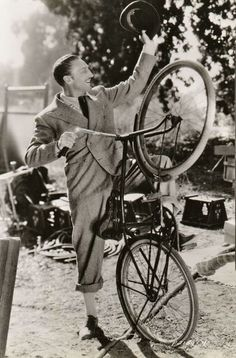"""ridesabike:  Warren William rides a bike. """"ON A SPIRITED REARING STEED — Warren William, who makes his debut as a Mae West leading man in her latest starring picture, """"Go West Young Man,"""" laid aside his suave sophistication while on a location trip for scenes in the new film — and here's the result. William's prowess as a bicyclist speaks for itself."""""""