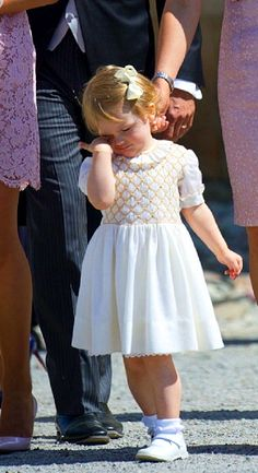 Swedish Princess Estelle leave the Royal Chapel in Drottningholm's palace near Stockholm after christening of her cousin Princess Leonore  in June 2014.