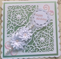 This card is using the spellbinders decorative blossom corner www.delabur.co.uk