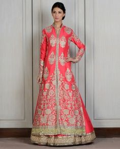 Jacket: Coral silk front open Nehru collar long jacket with Tilla embroidery motifs all over front and back. Heavy zardozi embroidered border and long side slits. Skirt: Coral silk Lehnga with thick hand sewn sequins border. No Dupatta.