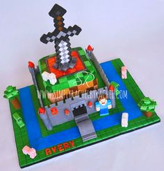 Minecraft Birthday 2 tier square cake. Handmade fondant figures and sword insert!  Fondant topping and buttercream filling.