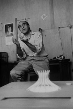 Architect Oscar Niemeyer in his office in front of a model of Brasilia's Cathedral on Feb. 1, 1960.