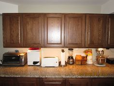 "Six Craigslist 36"" wide kitchen cabinets, were originally installed for a pantry but got returned. They were $600, not including delivery. The bottom cabinets are 34.5"" tall by 18"" deep and have no toe kick. The top cabinets are 30"" tall by 14.5"" deep.  The Craigslist granite countertop is 34.5 inch deep by 118 inch long by 1.25"" thick. It was $300, not including delivery."