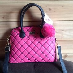 Betsey Johnson love Betsy handbag Pretty in pink with black hearts to get it just the right touch. This fuchsia colored satchel with an detachable Pom kitten made just for the girly girl and us.  Also comes with a 24 inch adjustable strap. The inside is also beautifully colored with black-and-white stripes and hot pink Betsey Johnson logo. Betsey Johnson Bags Satchels