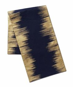 Enchanted Ikat Table Runner  |   A navy cotton runner with strokes of gold painted along its edges makes for a stunning base to your centerpiece. Could even be used to adorn a buffet. Measures 14 inches by 90 inches.  To buy: $24, westelm.com