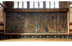 """(The tapestry in St. Mary's Guildhall.) """"The marquess came to a halt and cleared his throat. 'Allow me to describe the scene before us. Pairs of angelic musicians grace the trusses overhead. We face a wall with nine stained glass windows depicting the rulers of England. Below hangs a spectacular Tournai tapestry that looks to be of Alexander the Great meeting King Darius.'"""""""