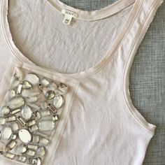✨New Listing✨J.Crew Rhinestone Application Top Pale pink/ grayish J.Crew top with rhinestones application at front. Minor spots at front (Not sure what it is. Looks like possible bleach marks to me.), that are not really visible. Plus a tiny hole that I fixed. See 2nd and 4th picture. Otherwise in great condition. J. Crew Tops Tank Tops